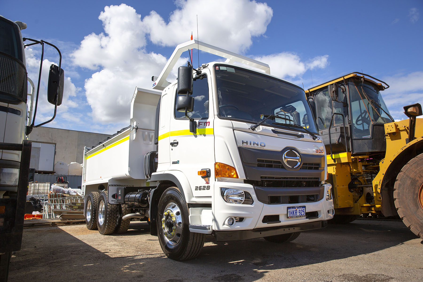 Hino 6 wheel tipper truck front side view