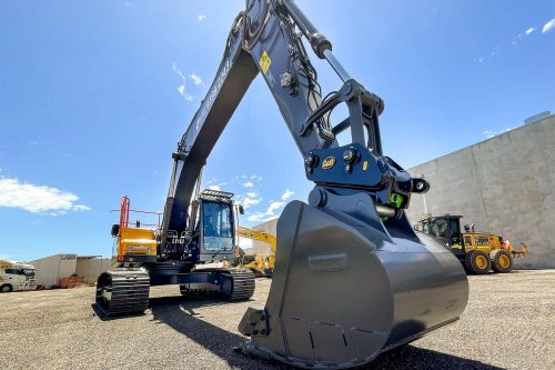 Volvo EC220DL Excavator with lowered arm and bucket on the ground